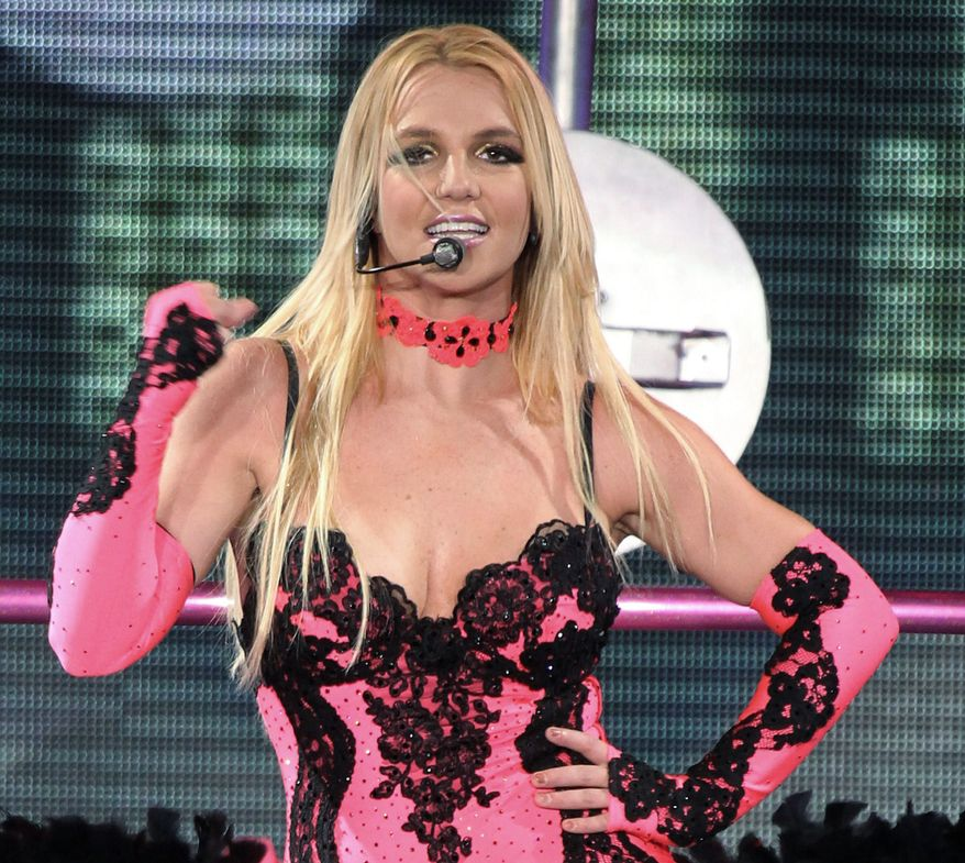 "Britney Spears is joining the judges table on Simon Cowell's ""X Factor."" She appeared Monday at Fox's presentation about new shows along with Demi Lovato, who also is joining as a judge, plus Mr. Cowell and judge L.A. Reid. (Associated Press)"