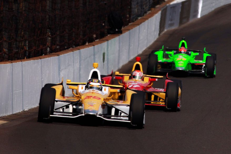 Ryan Hunter-Reay, Sebastian Saavedra and James Hinchcliffe draft during practice Sunday for the Indianapolis 500, set for May 27. (Associated Press)