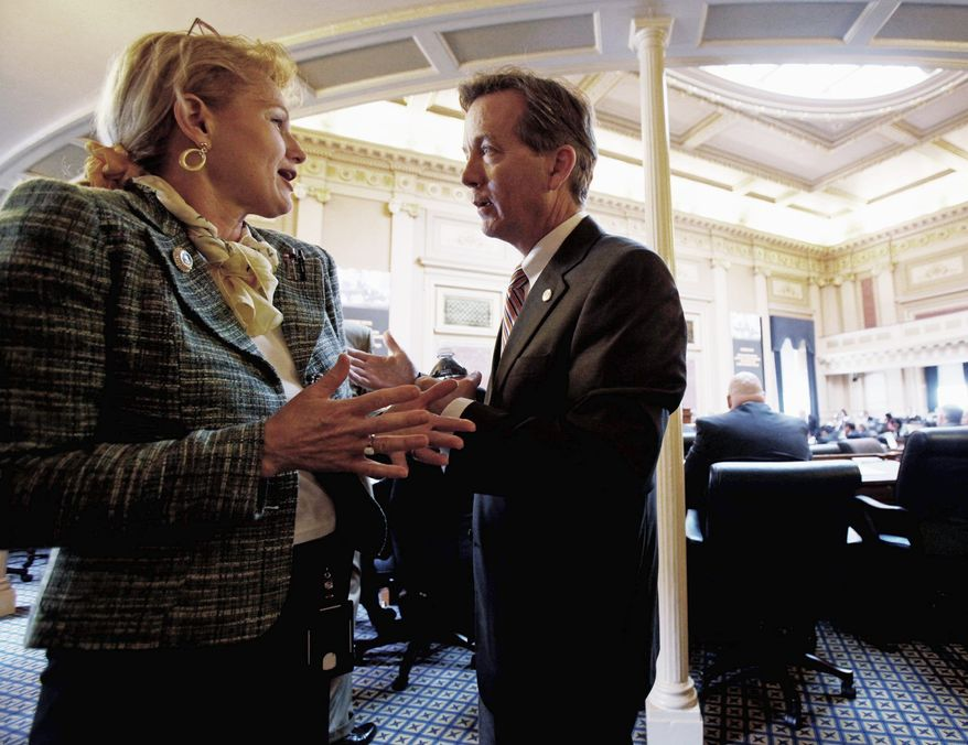 """ASSOCIATED PRESS Delegate S. Chris Jones speaks Monday with House Appropriations Committee staff member Susan Hogge. After a budget amendment proposed by Gov. Bob McDonnell was rejected, Mr. Jones suggested it was """"inartfully drawn."""""""