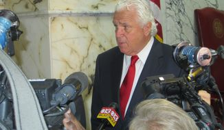 Senate President Thomas V. Mike Miller Jr., Prince George's Democrat, talks to the news media at the start of a special session of the Maryland General Assembly on Monday in Annapolis. The chamber gave preliminary approval to income tax increases. (Associated Press)