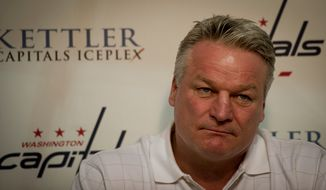 Washington Capitals head coach Dale Hunter answers questions from reporters during the Caps' last Media Day at the Kettler Capitals Iceplex in Arlington, Va., on Monday, May 14, 2012, following their elimination from the Stanley Cup playoffs in Game 7 of the National Hockey League Eastern Conference semifinals again the New York Rangers. (Rod Lamkey Jr./The Washington Times)