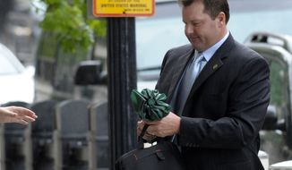 Former Major League Baseball pitcher Roger Clemens, who is on trial for perjury, arrives May 14, 2012, at federal court in Washington. (Associated Press)