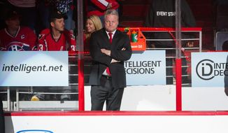 Washington Capitals head coach Dale Hunter comes stands in the bench area before the start of the first period as the Washington Capitals take on the New York Rangers in game six of the NHL eastern conference playoffs semifinals at the Verizon Center, Washington, D.C., Wednesday, May 9, 2012 (Andrew Harnik/The Washington Times)