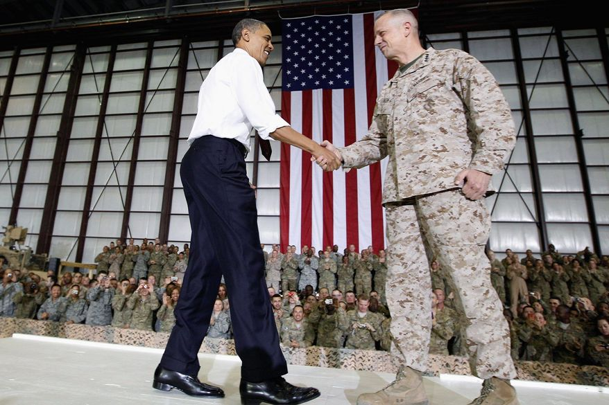 Marine Gen. John R. Allen, commander of the International Security Assistance Force and U.S. Forces Afghanistan, introduces President Obama at Bagram Air Field on May 2. As president, Mr. Obama has continued and even built upon strategies he inherited from George W. Bush. (Associated Press)