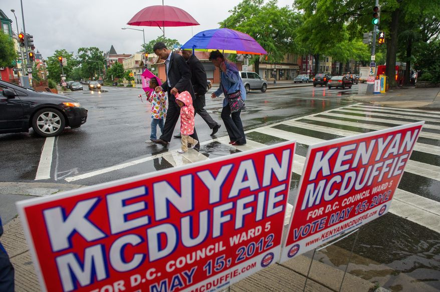 Kenyan McDuffie, a candidate to replace Harry Thomas for Ward 5 city councilmember, comes to cast his vote in the special election with his wife Princess, right, and his two daughters Kesi, 5, and Jozi, 2, at Mt. Bethel Baptist Church on Rhode Island Avenue in northwest, Washington, D.C., Tuesday, May 15, 2012 (Andrew Harnik/The Washington Times)