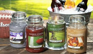 """Man Town, First Down, Riding Mower and 2x4 are the scents in the Yankee Candle Co.'s new Man Candles Collection. The """"down-to-earth fragrances"""" are meant to suit one's basement, garage, car, man cave or bachelor pad. (Village Candle Co. Inc.)"""
