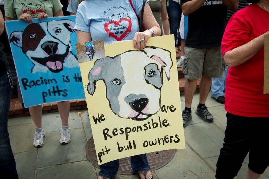More than 100 people rallied outside the State House in to support emergency legislation that would muzzle the far-reaching opinion on pit bulls and pit bull mixes. (Rod Lamkey Jr./The Washington Times)