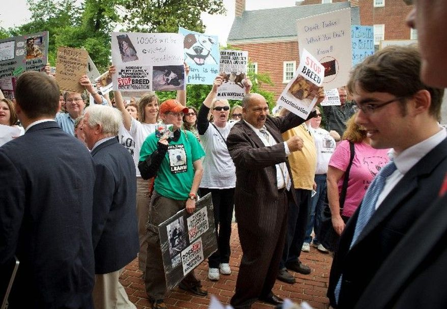 "Maryland Delegate Curtis S. Anderson (center) joins demonstrators at the State House in Annapolis on Tuesday in protesting the Court of Appeals of Maryland's opinion last month declaring pit bulls and pit bull mixes ""inherently dangerous."" (Rod Lamkey Jr./The Washington Times)"