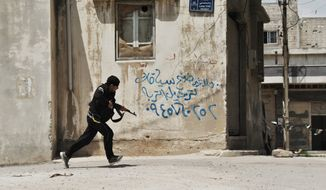 A Syrian rebel runs for cover in the Sunni district of Jabb al-Jandali in Homs, Syria, on Monday, May 14, 2012.  (AP Photo/Fadi Zaidan)