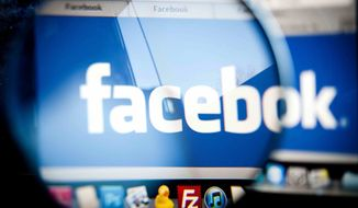 ** FILE ** This Feb. 1, 2012, photo shows the Facebook logo on a computer screen in Berlin. (AP Photo/dapd, Timur Emek)