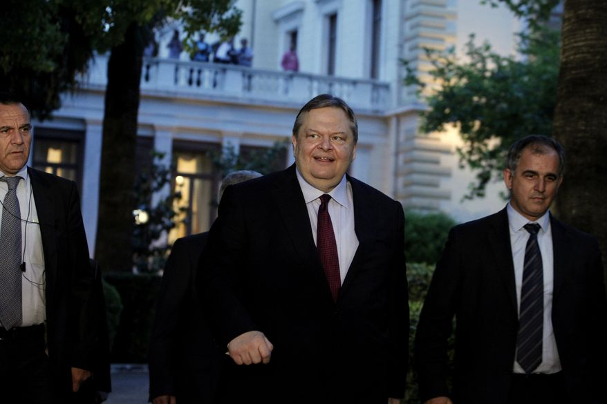 Evangelos Venizelos (center), leader of Greece's socialist PASOK party, leaves the Presidential Palace in Athens after a meeting with President Karolos Papoulias on Monday, May 14, 2012. (AP Photo/Petros Giannakouris )