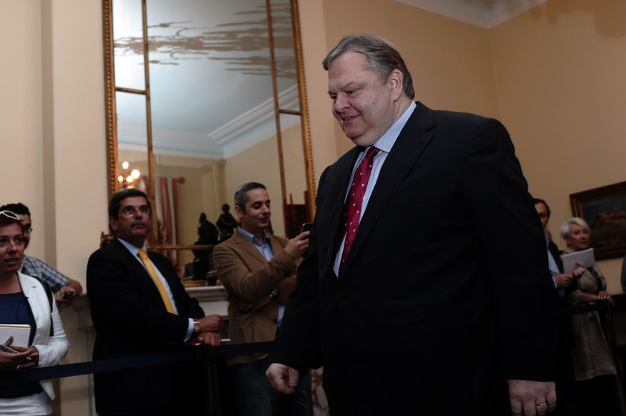 Evangelos Venizelos, leader of Greece's socialist PASOK party, arrives for a meeting with the country's president and other party leaders at the Presidential Palace in Athens on Tuesday, May 15, 2012. (AP Photo/Aris Messinis, Pool)