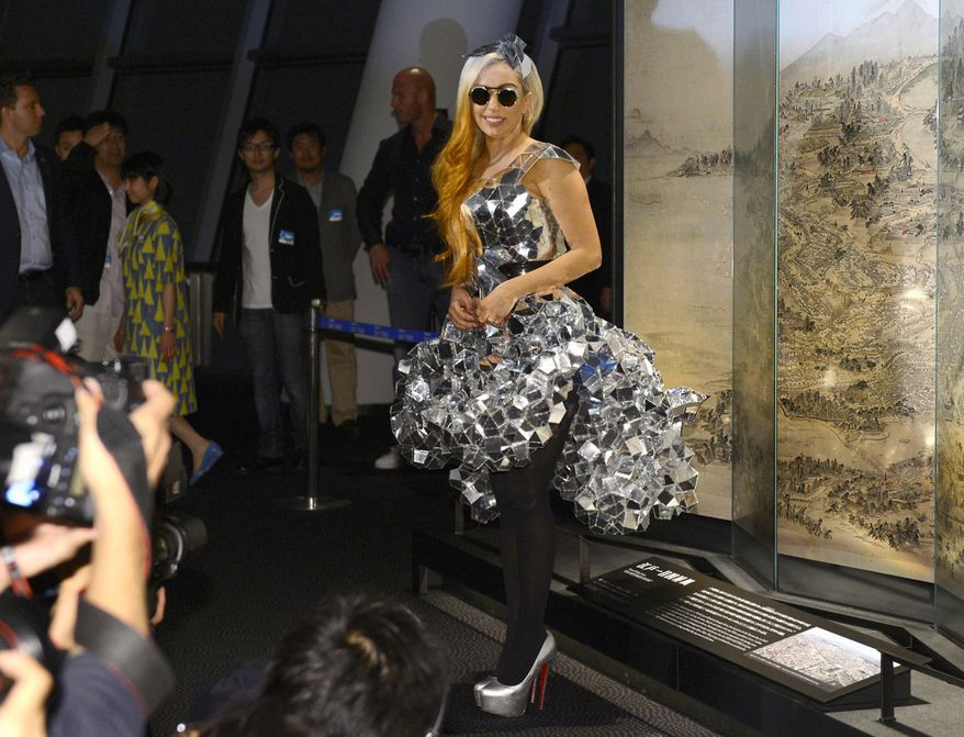 Lady Gaga poses during a visit to the Tokyo Sky Tree, the world's tallest free-standing broadcast structure, in Tokyo on Tuesday, May 15, 2012. (AP Photo/Kyodo News)
