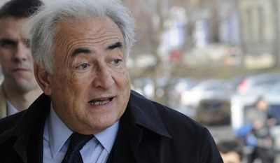Former International Monetary Fund leader Dominique Strauss-Kahn enters a building before his lecture at the Ukrainian Diplomatic Academy in Kiev on April 4, 2012. (AP Photo/Sergei Chuzavkov)