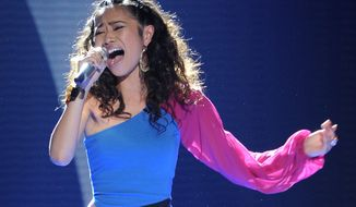"In this May 9, 2012 photo released by Fox, contestant Jessica Sanchez performs on the singing competition series ""American Idol,"" in Los Angeles. (AP Photo/Fox, Michael Becker)"