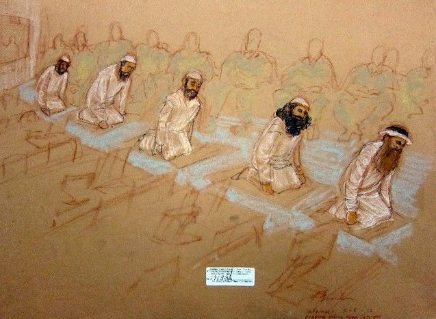 A sketch by a courtroom artist depicts the five 9/11 co-defendants praying during their arraignment at the U.S. Naval Base Guantanamo Bay, Cuba, on May 5. Their disruptive tactics stretched out the proceedings to 13 hours. (Associated Press)
