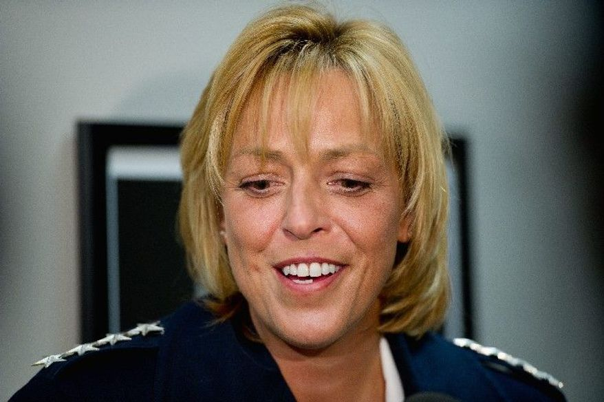 """D.C. Police Chief Cathy L. Lanier's new five-year contract includes an indemnification clause  that protects her from lawsuits, which the mayor says is """"standard"""" but a police representative  calls a """"red flag."""" (Andrew Harnik/The Washington Times)"""