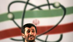 ** FILE ** In this Monday, April, 9, 2007, file photo Iranian President Mahmoud Ahmadinejad, speaks at a ceremony in Iran's nuclear enrichment facility in Natanz, 300 Kilometers (186 miles) south of capital Tehran, Iran. (AP Photo/Hasan Sarbakhshian, File)
