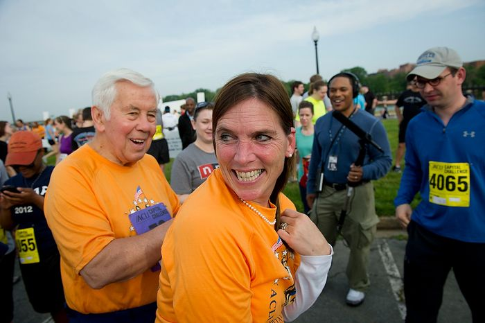 Senator Richard Lugar (R-Ind.) signs the tee shirt of supporter Margot Teetor, of Kennett Square, Pa., as he prepares to run in the ACLI Capital Challenge at Anacostia Park in Washington, D.C., Wednesday, May 16, 2012. This is the 31st running of the three-mile race where members of Congress, national media outlets and locals take part in this fundraising event in the early morning hours along the water of the Anacostia River.  (Rod Lamkey Jr/The Washington Times)