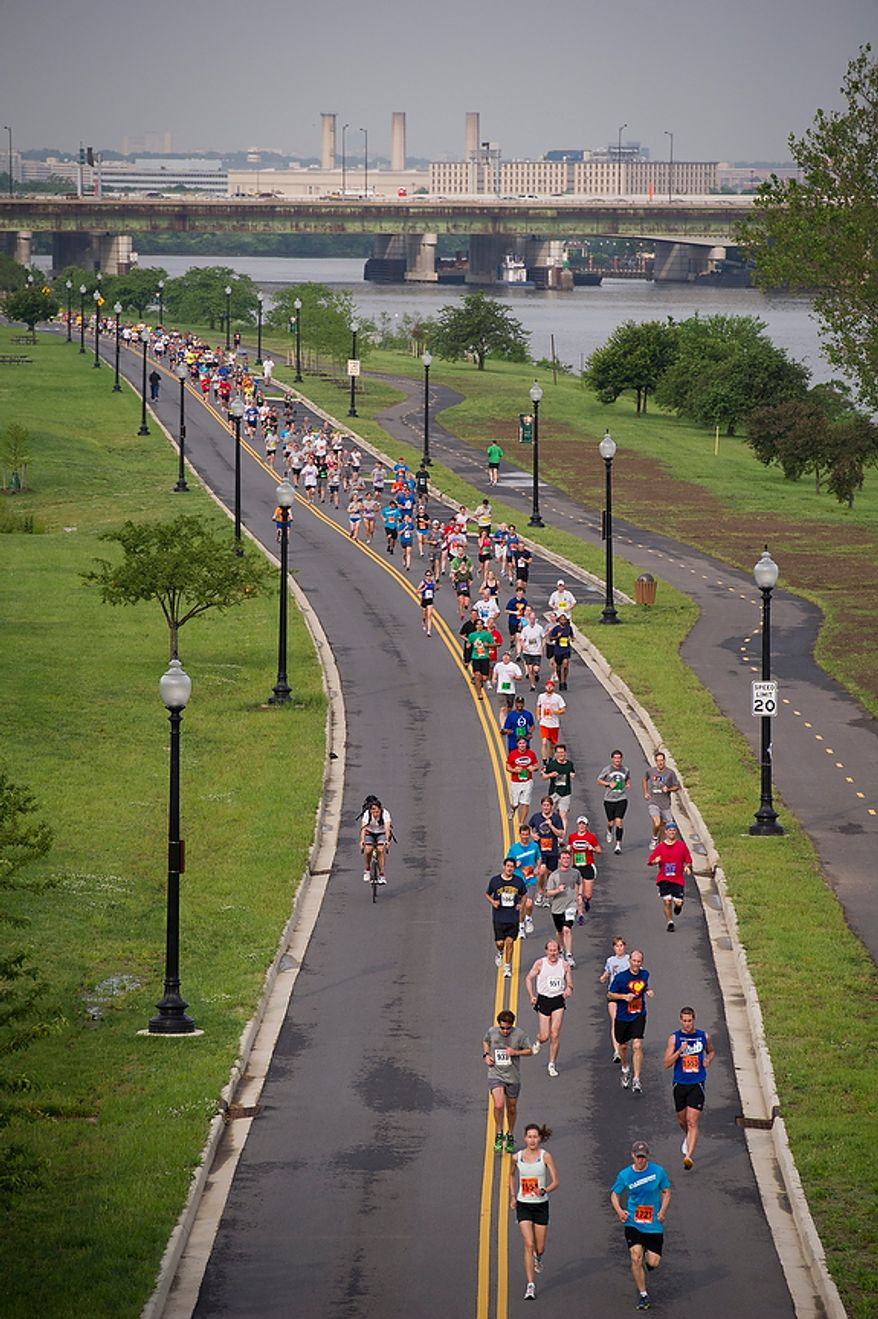 Runners make their way to the finish line during the ACLI Capital Challenge at Anacostia Park in Washington, D.C., Wednesday, May 16, 2012. This is the 31st running of the three-mile race where members of Congress, national media outlets and locals take part in this fundraising event in the early morning hours along the water of the Anacostia River.  (Rod Lamkey Jr/The Washington Times)