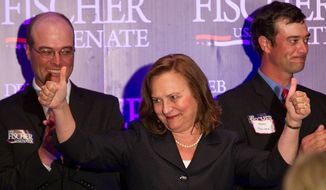 State Sen. Deb Fischer raises her hands with her sons Morgan, left, and Adam after winning the Republican primary for the U.S. Senate Tuesday, May 15, 2012, in Lincoln, Neb. Fischer will face Democrat Bob Kerrey in the November general election. (AP Photo/The Omaha World-Herald,Mark Davis)