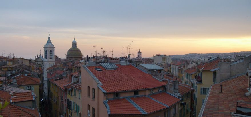 "The rooftops of Old Nice at sunset in Nice, France. The picturesque setting of the Riviera has been the backdrop for a number of movies including ""To Catch a Thief."" (Associated Press)"
