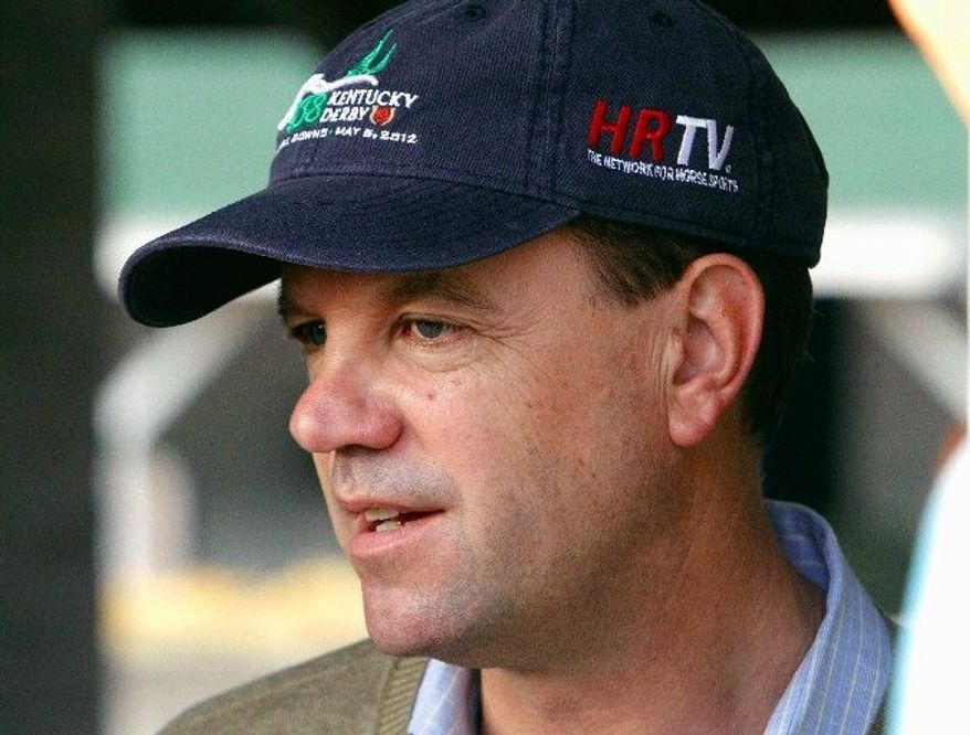 H. Graham Motion, trainer of fourth-place Kentucky Derby finisher Went the Day Well, speaks to reporters at Churchill Downs in Louisville, Ky., Sunday, May 6, 2012. (AP Photo/Garry Jones)