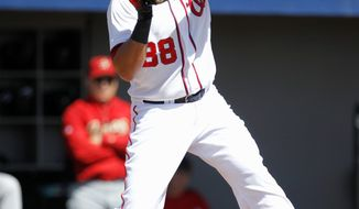 Michael Morse hit 31 home runs with 95 RBI while batting .303 for the Nationals last season. He's missed the entire 2012 season with a torn right lat muscle, however. (Associated Press)