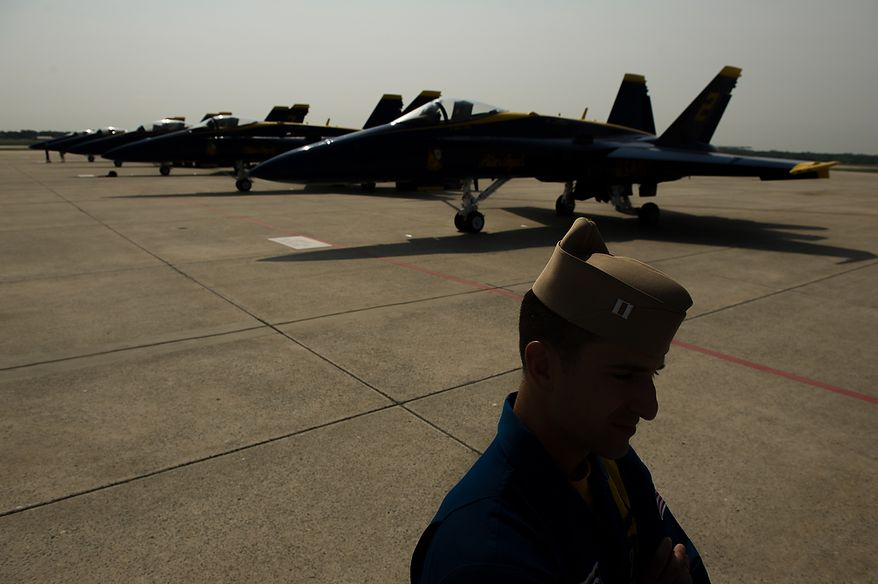 Lt. Mark Tedrow with the U.S. Navy's Blue Angels flight demonstration squadron stands near the squad's aircrafts on the tarmac at Andrews Air Force Base, Naval Air Facility, Md., Thursday, May 17, 2012.  The 2012 Joint Service Open House and Air Show will be held at Andrews Air Force Base Saturday May 19th and Sunday May 20th. (Andrew Harnik/The Washington Times)