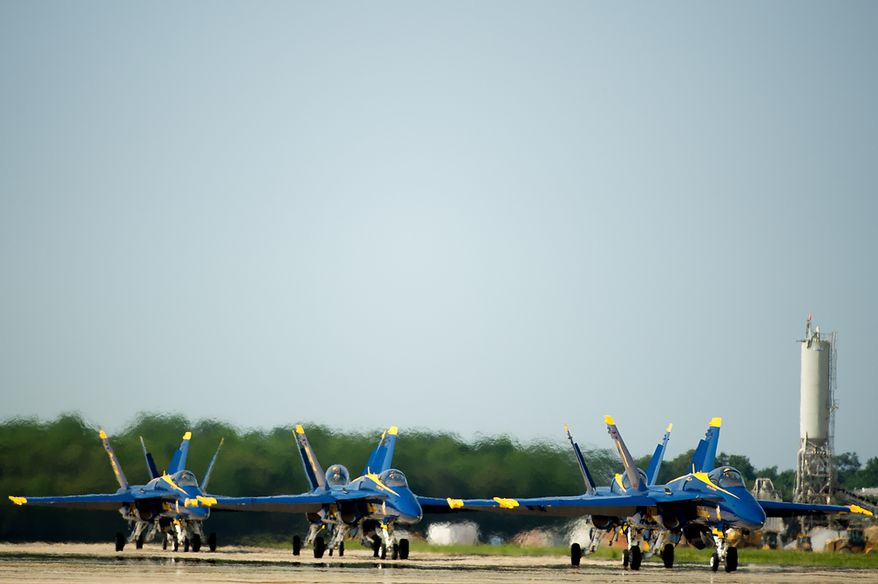 The U.S. Navy's Blue Angels flight demonstration squadron returns from an afternoon practice in preparation for the 2012 Joint Service Open House and Air Show to be held at Andrews Air Force Base Saturday May 19th and Sunday May 20th, Naval Air Facility, Md., Thursday, May 17, 2012. (Andrew Harnik/The Washington Times)