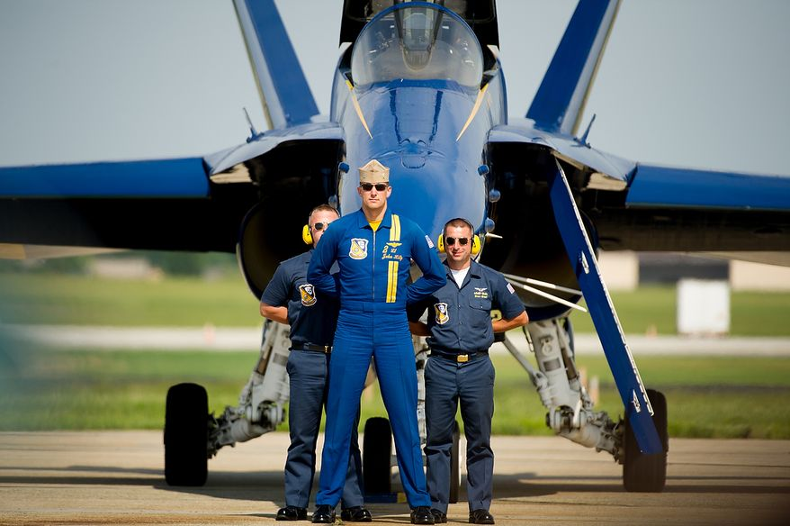 Lt. John Hiltz, center, stands in front of his aircraft with ground crew members after the U.S. Navy's Blue Angels flight demonstration squadron returns from an afternoon practice in preparation for the 2012 Joint Service Open House and Air Show to be held at Andrews Air Force Base Saturday May 19th and Sunday May 20th, Naval Air Facility, Md., Thursday, May 17, 2012. (Andrew Harnik/The Washington Times)