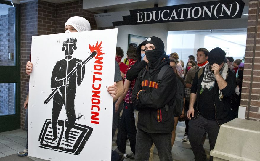 Protesters make their way through the hall of a Montreal university to disrupt classes Wednesday, May 16, 2012, in Montreal. (AP Photo/The Canadian Press, Paul Chiasson)