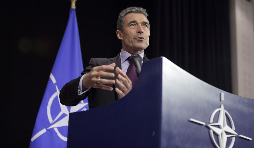 ** FILE ** NATO Secretary General Anders Fogh Rasmussen addresses the media at NATO headquarters in Brussels on Wednesday, April 18, 2012. The United States and its NATO allies are readying plans to pull away from the front lines in Afghanistan next year as President Barack Obama and fellow leaders try to show that the unpopular war is ending. (AP Photo/Virginia Mayo)