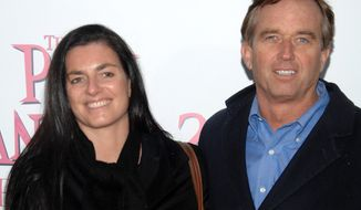 "Robert F. Kennedy Jr. and his wife, Mary Richardson Kennedy, arrive at the premiere of ""The Pink Panther 2"" at the Ziegfeld Theatre in New York in February 2009. (AP Photo/Peter Kramer)"