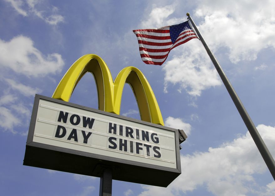 **FILE** A sign advertises job openings outside a McDonald's restaurant in Chesterland, Ohio, on May 2, 2012. (Associated Press)