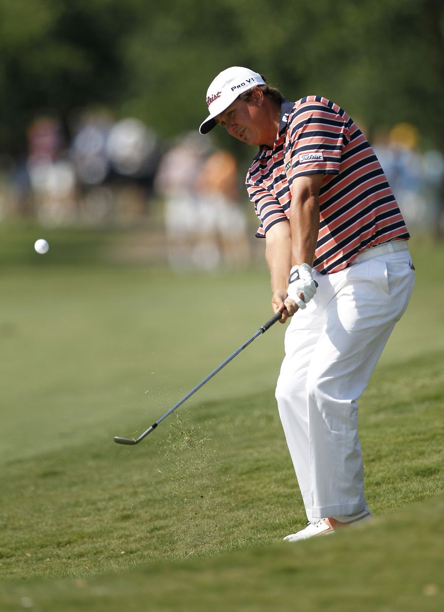 Jason Dufner chips onto the 16th green during the second round of the PGA Byron Nelson Championship on Friday, May 18, 2012, in Irving, Texas. Dufner finished with a two-round score of 7-under-par (AP Photo/Tony Gutierrez)