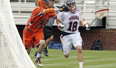 Virginia's Rob Fortunato (18) is defended by Princeton's Chris White (29) after advancing the ball during Virginia's 6-5 win in the first round of the NCAA lacrosse tournament Sunday, May 13, 2012, in Charlottesville, Va. (AP Photo/The Daily Progress, Andrew Shurtleff)
