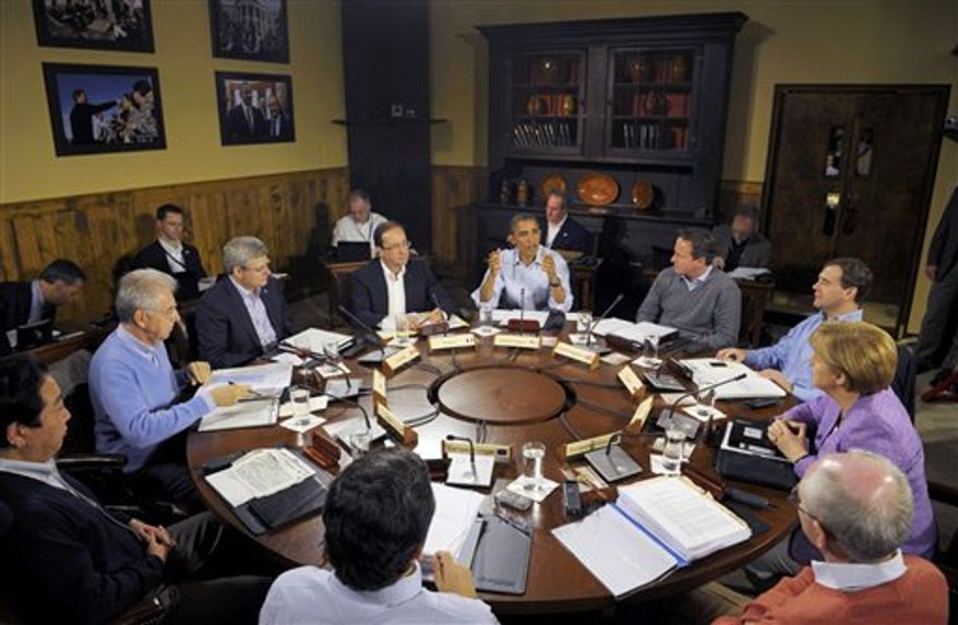 U.S. President Barack Obama, center, speaks at the start of the first working session of the G8 Summit at Camp David, Md., Saturday May 19, 2012. Seated, clockwise from left, are Japanese Prime Minister Yoshihiko Noda, Italian Prime Minister Mario Monti, Canadian Prime Minister Stephen Harper, French President Francois Hollande, Obama, British Prime Minister David Cameron, Russian Prime Minister Dmitry Medvedev, German Chancellor Angela Merkel, European Council President Herman Van Rompuy, and European Commission President Jose' Manuel Barroso, backs to camera. (AP Photo/Philippe Wojazer, Pool)