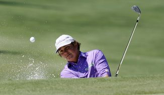 Jason Dufner hits out of the sand on the 16th hole during the third round of the PGA Byron Nelson Championship golf tournament Saturday, May 19, 2012, in Irving, Texas. (AP Photo/LM Otero)