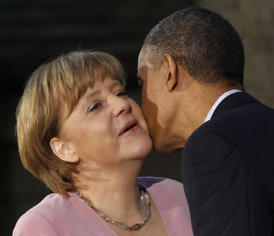 ** FILE ** President Obama kisses German Chancellor Angela Merkel on the cheek on her arrival for the G-8 summit on Friday, May 18, 2012, at Camp David, Md. (AP Photo/Charles Dharapak)