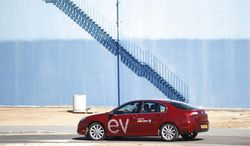 ** FILE ** In this Sunday, Feb. 7, 2010. file photo an electric car is seen during a demonstration of the California-based company Better Place in Tel Aviv, Israel. Israeli entrepreneur Shai Agassi has developed the world's first nationwide electric car network. (AP Photo/Ariel Schalit, File)