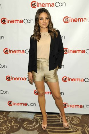"""** FILE ** In this Tuesday, April 24, 2012, file photo, Mila Kunis, a cast member in the upcoming film """"Oz: The Great and Powerful,"""" poses before the Walt Disney Studios Motion Pictures presentation at CinemaCon 2012, the official convention of the National Association of Theater Owners, in Las"""