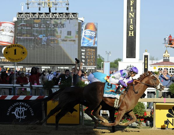 I'll Have Another (9), ridden by Mario Gutierrez, beats Bodemeister, ridden by Mike Smith, to the finish line to win the 137th Preakness Stakes at Pimlico Race Course on Saturday, May 19, 2012, in Baltimore. (AP Photo/Mike Stewart)