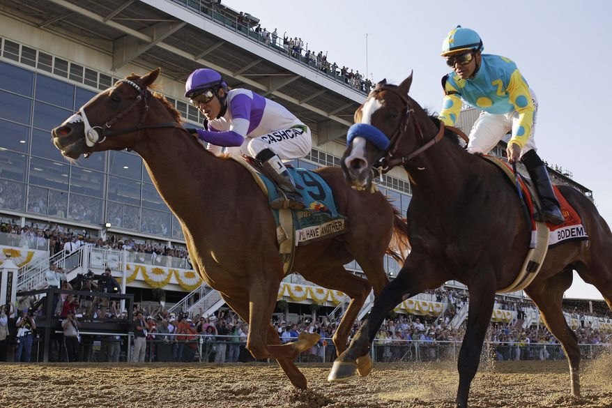 I'll Have Another (9), ridden by Mario Gutierrez, beats Bodemeister, ridden by Mike Smith, to the finish line to win the 137th Preakness Stakes at Pimlico Race Course on Saturday, May 19, 2012, in Baltimore. (AP Photo/Matt Slocum)