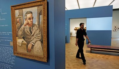 An oil on canvas portrait by Giorgio de Chirico of Dr. Albert C. Barnes hangs at the Barnes Foundation. The art collection opened to the public at its new location on Saturday. The Barnes expects 250,000 visitors to see the collection during its first year. (Associated Press)