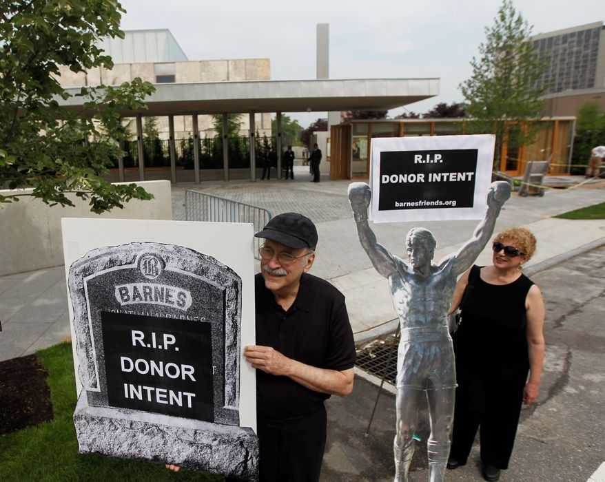 Protesters picket outside a preview of the Barnes Foundation last week in Philadelphia. Moving the collection to the city from suburban Merion happened only after years of bitter court fights. (Associated Press)