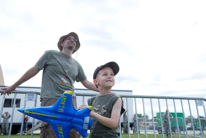 Tony Kirvan and his son Michael, 6, of Millersville, Md., watch the planes. (Barbara L. Salisbury/The Washington Times)