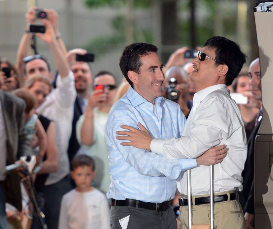 Blind Chinese legal activist Chen Guangcheng (right) arrives at Washington Square Village on the campus of New York University on Saturday, May 19, 2012, in New York. (AP Photo/Henny Ray Abrams)