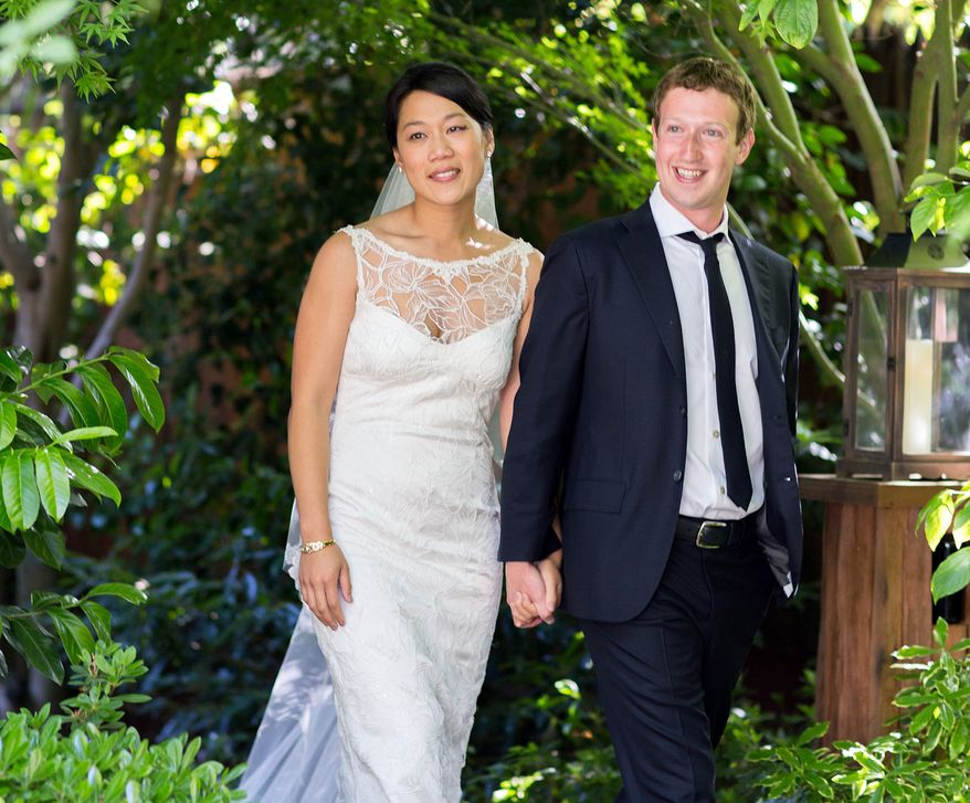 Facebook founder and CEO Mark Zuckerberg and Priscilla Chan, his longtime girlfriend, were married in Palo Alto, Calif., on Saturday, May 19, 2012. (AP Photo/Facebook, Allyson Magda Photography)