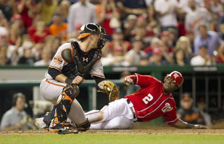 Washington Nationals center fielder Roger Bernadina (2) slides in safely to home plate after a single by second baseman Stephen Lombardozzi in the fifth inning of the Orioles' 6-5 road win on May 19, 20